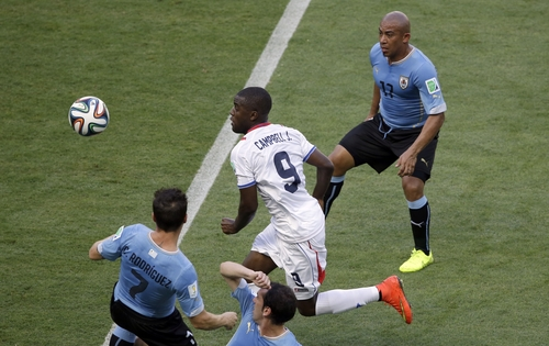 Costa Rica's Joel Campbell is flanked by Uruguay's Cristian Rodriguez, left, and Uruguay's Egidio Arevalo Rios during the group D World Cup soccer match between Uruguay and Costa Rica at the Arena Castelao in Fortaleza, Brazil, Saturday, June 14, 2014.  (AP Photo/Sergei Grits)