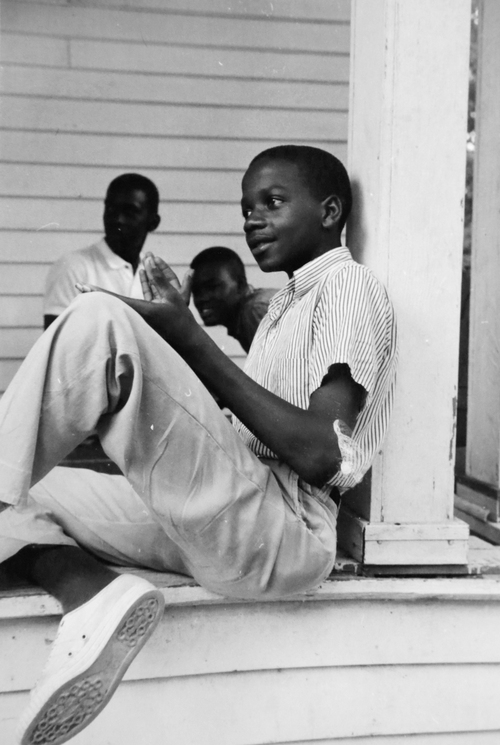 "ADVANCE FOR USE SUNDAY, JUNE 15, 2014, AND THEREAFTER - This 1964 photo, provided by Michael Clurman, shows Roy DeBerry at a ""Freedom School"" in Holly Springs, Miss. DeBerry, nicknamed ""Shorty"" by his classmates, said that he liked how Aviva Futorian, a young history teacher and volunteer at the school, ""took my views seriously, even though I was a very young person."" It was his first interaction with a white person ""on a social level."" (AP Photo/Michael Clurman)"