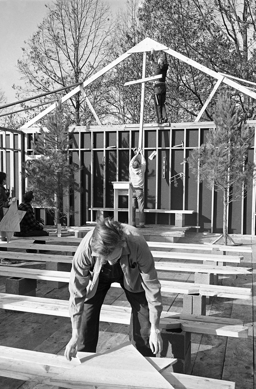 ADVANCE FOR USE SUNDAY, JUNE 15, 2014, AND THEREAFTER - FILE - In this Dec. 25,1964 file photo, white students from Oberlin College, in Oberlin, Ohio put last minute touches to the interior of the Antioch Baptist Church before services were held Dec. 25, 1964, in Ripley, Miss. The volunteers gave up their Christmas holidays to rebuild the church that was burned after a civil rights rally on Oct. 30. (AP Photo/Bill Hudson, File)