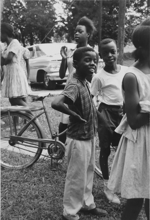 "ADVANCE FOR USE SUNDAY, JUNE 15, 2014, AND THEREAFTER - This 1964 photo, provided by Michael Clurman, shows unidentified children at a ""Freedom School"" in Holly Springs, Miss. The schools and community centers aimed to help prepare those long disenfranchised for participation in the political process. (AP Photo/Michael Clurman)"