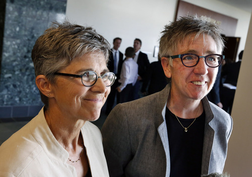 Plaintiffs in a gay marriage case and longtime couple Rebecca Brinkman, left, and Margaret Burd take questions from members of the media following a hearing at Adams County District Court, in Brighton, Colo., on Monday, June 16, 2014. Colorado's gay marriage ban appears to be on thin ice after a judge hearing two lawsuits challenging the measure noted that 15 other judges have recently struck down similar bans. (AP Photo/Brennan Linsley)