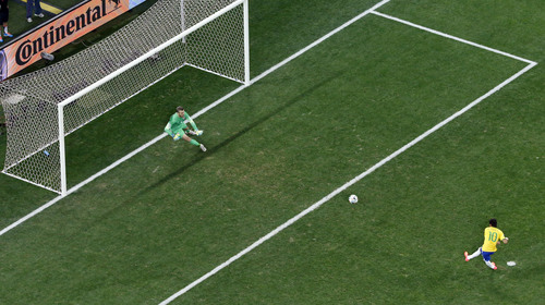 Brazil's Neymar scores against Croatia's goalkeeper Stipe Pletikosa on a penalty kick during the group A World Cup soccer match between Brazil and Croatia, during the opening game of the tournament, in the Itaquerao Stadium in Sao Paulo, Brazil, Thursday, June 12, 2014. (AP Photo/Fabrizio Bensch, Pool)