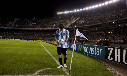 Argentina's Lionel Messi holds the ball before making a corner kick at a World Cup 2014 qualifying soccer game against Ecuador in Buenos Aires, Argentina, Saturday, June 2, 2012. (AP Photo/Natacha Pisarenko)