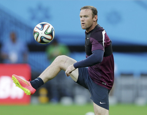 England's Wayne Rooney juggles during a training session at Arena da Amazonia in Manaus, Brazil, Friday, June 13, 2014.  England plays in group D of the 2014 soccer World Cup. (AP Photo/Antonio Calanni)