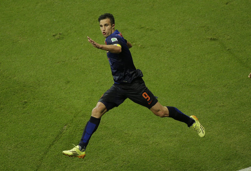 Netherlands' Robin van Persie celebrates after scoring a goal during the group B World Cup soccer match between Spain and the Netherlands at the Arena Ponte Nova in Salvador, Brazil, Friday, June 13, 2014.  (AP Photo/Christophe Ena)