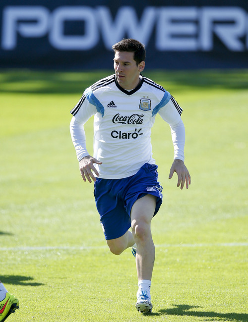 Argentina's Lionel Messi runs during a training session in Vespasiano, near Belo Horizonte, Brazil, Friday, June, 13, 2014. Argentina will play in group F of the Brazil 2014 soccer World Cup. (AP Photo/Victor R. Caivano)