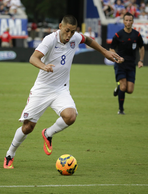 United States's Clint Dempsey (8) moves the ball against Nigeria during the second half of an international friendly soccer match in Jacksonville, Fla., Saturday, June 7, 2014. The United States won 2-1. (AP Photo/John Raoux)