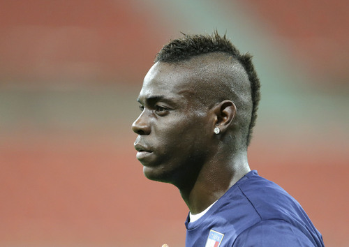 Italy forward Mario Balotelli attends at  an official training session the day before the group D World Cup soccer match between England and Italy at the Arena da Amazonia in Manaus, Brazil, Friday, June 13, 2014. (AP Photo/Antonio Calanni)