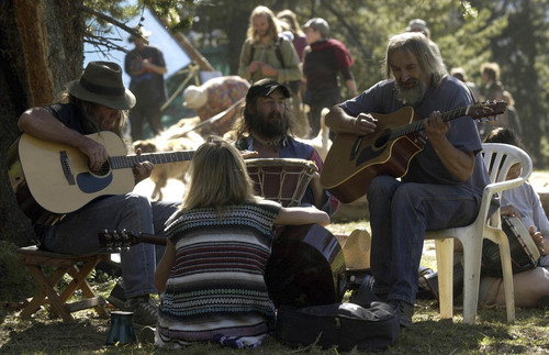 The 2003 annual gathering of the Rainbow Family was on forest service land near Lyman Lake in the Wasatch National Forest in the Uinta Mountains in Utah. Rainbow sisters and brothers hold an impromptu jam session for fun.   Photo taken by Leah Hogsten,  07/01/2003