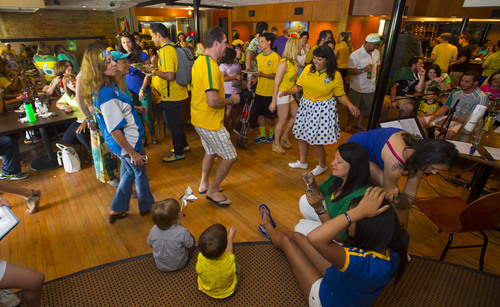 Steve Griffin  |  The Salt Lake Tribune   Soccer fans dance to live music and celebrate prior to the start of the Brazil versus Croatia World Cup soccer match at  Rodizio Grill at Trolley Square in Salt Lake City on Thursday, June 12, 2014.