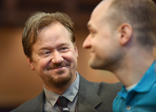 In this June 14, 2014 photo, Frank Schaefer, left, and his son Tim Schaefer speak before a ceremony where Frank Schaefer received an award for his public advocacy marking 10 years of legal gay marriage in Massachusetts, at Old South Church, in Boston. Schaefer, a Methodist pastor who was defrocked for officiating his son Tim's wedding to another man, accepted the award the weekend before a Methodist judicial panel was scheduled to hear his appeal to continue in the ministry. (AP Photo/Josh Reynolds)