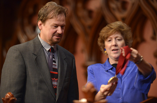 In this June 14, 2014 photo, Frank Schaefer, left. is shown the Open Door Award by Rev. Nancy Taylor, before a ceremony where Schaefer received the award for his public advocacy marking 10 years of legal gay marriage in Massachusetts, at Old South Church, in Boston. Schaefer, a Methodist pastor who was defrocked for officiating his son Tim's wedding to another man, accepted the award the weekend before a Methodist judicial panel was scheduled to hear his appeal to continue in the ministry. (AP Photo/Josh Reynolds)