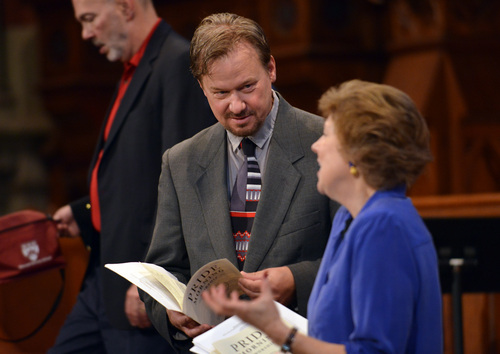 In this June 14, 2014 photo, Frank Schaefer, center, speaks with Rev. Nancy Taylor, right, before a ceremony where Schaefer received an award for his public advocacy marking 10 years of legal gay marriage in Massachusetts, at Old South Church, in Boston. (AP Photo/Josh Reynolds)