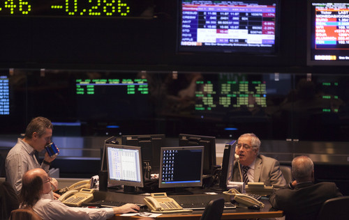 Brokers work at the Buenos Aires Stock Exchange in Buenos Aires, Argentina, Tuesday, June 17, 2014. Argentina's President Cristina Fernandez is refusing to go along with a U.S. judge's ruling requiring repayment of defaulted bonds. The Merval stock index dropped after Monday's court decision, its largest one-day loss in more than six months, and the value of Argentina's currency went down on the black market.  (AP Photo/Eduardo Di Baia)
