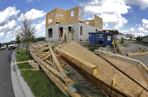 This Wednesday, May 14, 2014 photo taken with a fisheye lens shows a new home under construction in Riverview, Fla. The Conference Board reports on its index of leading economic indicators for May on Thursday, June 19, 2014. (AP Photo/Chris O'Meara)