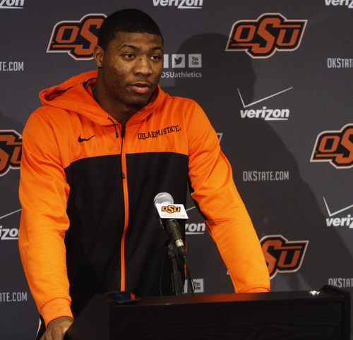 Oklahoma State basketball player Marcus Smart addresses members of the media at a news conference in Stillwater, Okla., Sunday, Feb. 9, 2014, in regard to an altercation during an NCAA college basketball game the day before. Smart was suspended three games by the Big 12 for shoving a fan. (AP Photo/The Oklahoman, KT King) LOCAL STATIONS OUT (KFOR, KOCO, KWTV, KOKH, KAUT OUT); LOCAL WEBSITES OUT; LOCAL PRINT OUT (EDMOND SUN OUT, OKLAHOMA GAZETTE OUT) TABLOIDS OUT