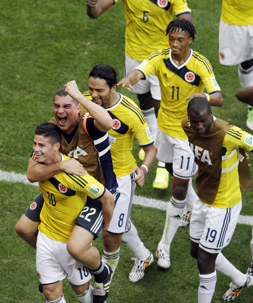 Colombia's James Rodriguez, left, celebrates with teammate  goalkeeper Faryd Mondragon during the group C World Cup soccer match between Colombia and Ivory Coast at the Estadio Nacional in Brasilia, Brazil, Thursday, June 19, 2014.  (AP Photo/Themba Hadebe)