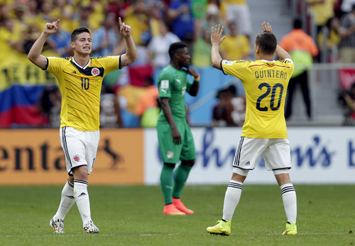 Colombia's James Rodriguez (10) celebrates with Juan Quintero (20) after scoring his side's opening goal during the group C World Cup soccer match between Colombia and Ivory Coast at the Estadio Nacional in Brasilia, Brazil, Thursday, June 19, 2014.  (AP Photo/Marcio Jose Sanchez)