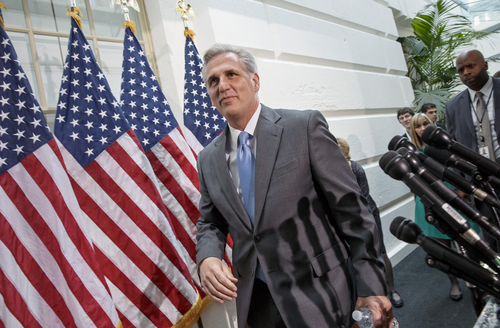 House Majority Whip Kevin McCarthy of Calif. leaves a  Republican Conference meeting on Capitol Hill in Washington, Wednesday, June 18, 2014, as candidates vying for House GOP leadership posts make their pitches to the rank-and-file in the tumultuous aftermath of House Majority Leader Eric Cantor's sudden loss last week in his Virginia primary race. (AP Photo/J. Scott Applewhite)