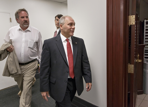 Rep. Steve Scalise, R-La., arrives for a meeting of the House Republican Conference on Capitol Hill in Washington, Wednesday, June 18, 2014, as he and other candidates vying for House GOP leadership posts make their pitches to the rank-and-file in the tumultuous aftermath of House Majority Leader Eric Cantor's sudden loss last week in his Virginia primary race.  With House Majority Whip Kevin McCarthy, R-Calif., the strong favorite to become the new majority leader, an intense intramural clash has emerged for the whip post between Rep. Scalise, who runs a conservative faction of lawmakers in the Republican Study Committee, and Chief Deputy Whip Peter Roskam, R-Ill., and  Rep. Marlin Stutzman, R-Ind.  (AP Photo/J. Scott Applewhite)