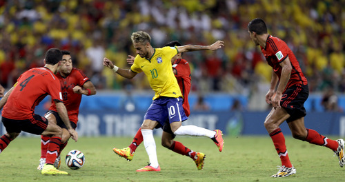 Brazil's Neymar is closed down by the Mexico defense during the group A World Cup soccer match between Brazil and Mexico at the Arena Castelao in Fortaleza, Brazil, Tuesday, June 17, 2014. (AP Photo/Andre Penner)