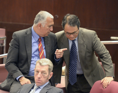 Al Hartmann  |  The Salt Lake Tribune Salt Lake County District Attorney Sim Gill, left, confers with Criminal Division Chiefs Blake Nakamura, right, and Jeff Hall, front, before a press conference to announce a manslaughter charge filed against a former West Valley City police detective in the 2012 shooting death of 21-year-old Danielle Willard