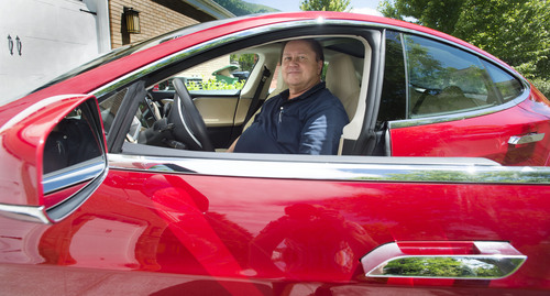 Steve Griffin  |  The Salt Lake Tribune  Rick Votaw sits in the driver's seat of his new $140,000 all-electric Tesla car in his Sandy, Utah home Friday, June 20, 2014. Votaw thought the car would qualify him for a clean air decal to allow free use of freeway express lanes. But UDOT has said it has reached its limit for those stickers, so it won't give him one.