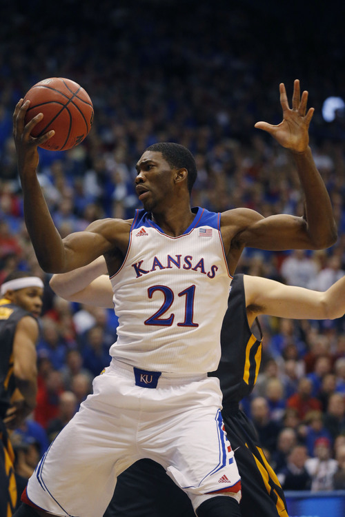 Kansas center Joel Embiid (21) during the first half of an NCAA college basketball game against Toledo at Allen Fieldhouse in Lawrence, Kan., Monday, Dec. 30, 2013. (AP Photo/Orlin Wagner)