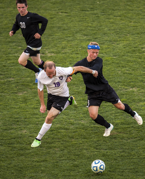 Chris Detrick  |  The Salt Lake Tribune Riverton's Hunter McFall (19) and Fremont's Brayden Searle (3) go for the ball during the 5A Championship game at Rio Tinto Stadium Thursday May 22, 2014.