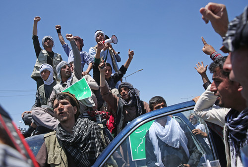 Supporters of presidential candidate Abdullah Abdullah shouts slogans during a protest in Kabul, Afghanistan, Saturday, June 21, 2014. Former Foreign Minister Abdullah, who is running against Ashraf Ghani Ahmadzai, a former finance minister, has accused electoral officials and others of trying to rig the June 14 vote against him. (AP Photo/Massoud Hossaini)
