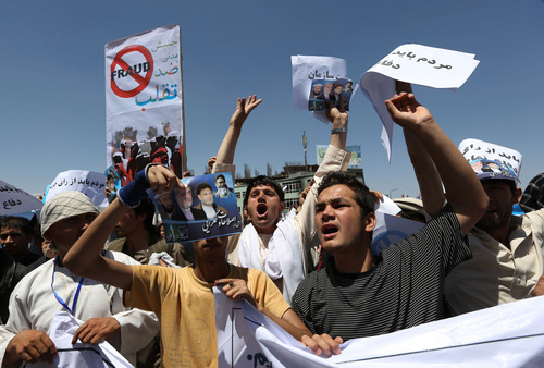 Supporters of presidential candidate Abdullah Abdullah shouts slogans during a protest in Kabul, Afghanistan, Saturday, June 21, 2014. Former Foreign Minister Abdullah, who is running against Ashraf Ghani Ahmadzai, a former finance minister, has accused electoral officials and others of trying to rig the June 14 vote against him. (AP Photo/Rahmat Gul)