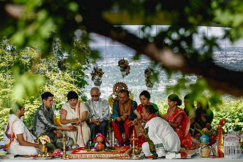 photo courtesy Nadia D Photography  Bride Avni Patel, groom Abhishek Dhingra and their parents participate in a Hindu ritual invoking the nine planets, during the first day of a three-day wedding ceremony Thursday, July 19, 2014. The wedding concludes on Saturday.
