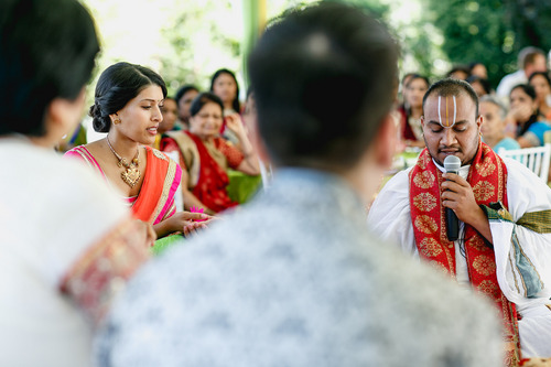 photo courtesy Nadia D Photography  Bride Avni Patel watches Hindu pandit Satish Kumar officiate a ritual in Holladay invoking the nine planets, during the first day of a three-day traditional Indian wedding ceremony Thursday, July 19, 2014. The wedding concludes on Saturday.