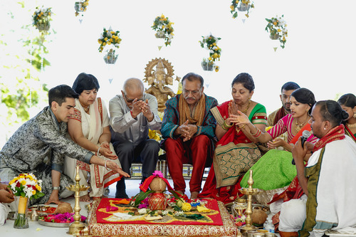 photo courtesy Nadia D Photography  Bride Avni Patel (second from far right) and groom Abhishek Dhingra (far left) join their parents in a Hindu ritual invoking the nine planets, during the first day of a three-day wedding ceremony Thursday, July 19, 2014. The wedding concludes on Saturday.