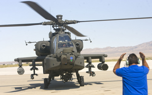 Al Hartmann  |  The Salt Lake Tribune Aircraft of the Unmanned System Integration Capability (MUSIC) was demonstrated at Dugway Proving Grounds Thursday Sepetmeber 15.   Apache helicopter lands after the excercise demonstration.
