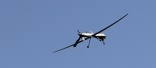 Salt Lake Tribune photo Gray Eagle drone practices manuevers over Dugway Proving Ground on June 18, 2014.