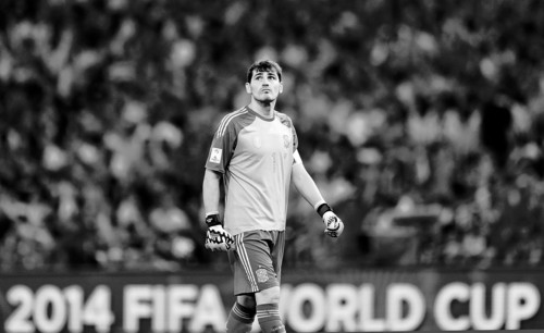 Spain's goalkeeper Iker Casillas looks up into the stands during the group B World Cup soccer match between Spain and Chile at the Maracana Stadium in Rio de Janeiro, Brazil, Wednesday, June 18, 2014. Defending champion Spain was eliminated from the World Cup after losing to Chile 2-0. (AP Photo/Natacha Pisarenko)