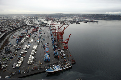 FILE - This Nov. 19, 2009 file photo shows shipping cranes at the Port of Seattle in downtown Seattle. The West Coast ports that are America's gateway for hundreds of billions of dollars of trade with Asia and beyond are no stranger to labor unrest and even violence. Now, the contract that covers nearly 20,000 dockworkers is set to expire, and businesses that trade in everything from apples to iPhones are worried about disruptions _ as the summer cargo crush begins.  (AP Photo/Elaine Thompson, file)
