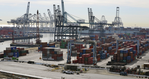 FILE - In this Jan.10, 2011 file photo, shipping containers line the Port of Long Beach in Long Beach, Calif. The West Coast ports that are America's gateway for hundreds of billions of dollars of trade with Asia and beyond are no stranger to labor unrest and even violence. Now, the contract that covers nearly 20,000 dockworkers is set to expire, and businesses that trade in everything from apples to iPhones are worried about disruptions _ as the summer cargo crush begins.   (AP Photo/Noaki Schwartz)