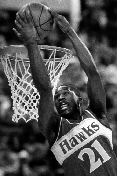 FILE--Atlanta Hawks forward Dominique Wilkins dunks the ball over his head during the NBA Slam Dunk Contest in this Feb. 9, 1985 photo in Indianapolis. The Atlanta Journal-Constitution reported Saturday, April 1, 2005, that former Hawks star Dominique Wilkins will be inducted in to the Basketball Hall of Fame.  (AP Photo/Doug Atkins)