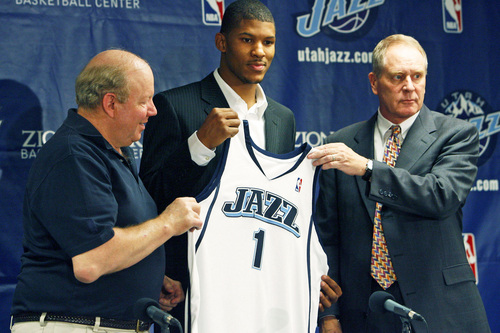 The Utah Jazz introduced first round pick Morris Almond with the 25th pick.  A press conference is held at the Jazz practice facility on Friday afternoon as he addressed the media. Here he is flanked by Jazz owner Larry Miller and  senior vice president of basketball operations Kevin O'Connor, right.