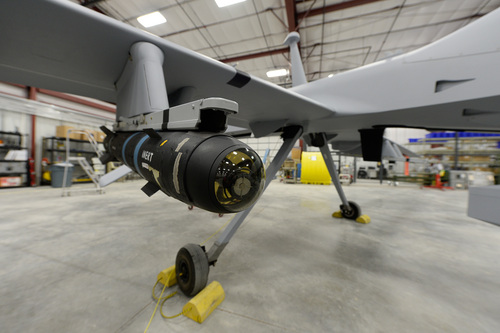 Francisco Kjolseth  |  The Salt Lake Tribune Most of the Army's testing for unmanned aerial vehicles (drones) happens at Dugway Proving Ground. In this photo from 2014, a model of an ordnance sits on the wing of a Gray Eagle.