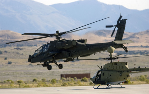 Al Hartmann  |  The Salt Lake Tribune Aircraft of the Unmanned System Integration Capability (MUSIC) was demonstrated at Dugway Proving Grounds Thursday Sepetmeber 15.  An Apache helicopter, left, takes off followed by a Kiowa during demonstration excercise.