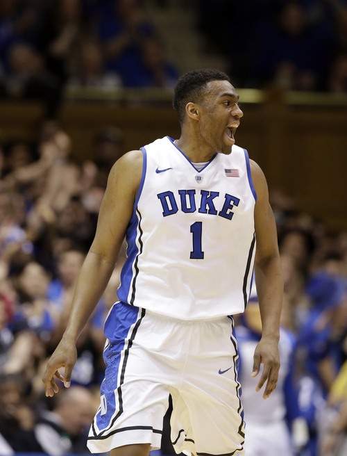 Duke's Jabari Parker (1) reacts following a basket against Florida State during the first half of an NCAA college basketball game in Durham, N.C., Saturday, Jan. 25, 2014. (AP Photo/Gerry Broome)