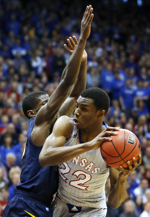 Kansas guard Andrew Wiggins (22) is covered by West Virginia guard Eron Harris, left, during the first half of an NCAA college basketball game in Lawrence, Kan., Saturday, Feb. 8, 2014. (AP Photo/Orlin Wagner)