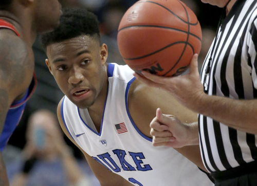 Duke forward Jabari Parker prepares for the tip-off during the first half of an NCAA college basketball game against Kansas Tuesday, Nov. 12, 2013, in Chicago. (AP Photo/Charles Rex Arbogast)