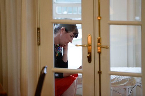 Francisco Kjolseth     The Salt Lake Tribune Kate Kelly, founder of Ordain Women, checks messages of support and requests for interviews during a quiet moment at a bed and breakfast near downtown Salt Lake City after getting an official message through email that she has been excommunicated from The Church of Jesus Christ of Latter-day Saints on Monday, June 23, 2014.