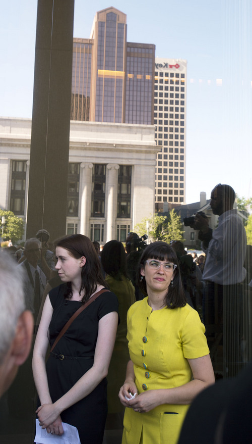 """Steve Griffin     The Salt Lake Tribune   Kate Kelly, founder of Ordain Women, stands outside the LDS Church Office Building in Salt Lake City, Utah Sunday, June 22, 2014, after saying """"I will not be silenced"""" in front of hundreds of her supporters. She also placed her marriage certificate at the door. The event coincided with the church disciplinary court underway at Kate's former stake center in Virginia. Kate no longer lives in Virginia, and is living in Utah before she moves to Kenya with her husband."""