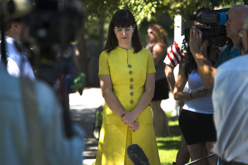 Steve Griffin  |  The Salt Lake Tribune   Kate Kelly, founder of the The Ordain Women organization, waits quietly prior to a vigil at City Creek Park, in Salt Lake City, Utah Sunday, June 22, 2014.  The event coincided with the church disciplinary court underway at Kate's former stake center in Virginia. Kate no longer lives in Virginia, and is living in Utah before she moves to Kenya with her husband..