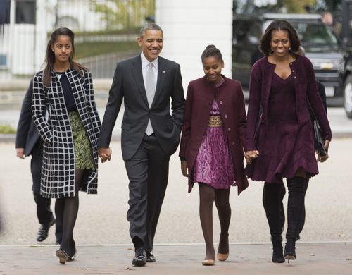 FILE - In this Oct. 27, 2013, file photo, President Barack Obama, second from left, with first lady Michelle Obama, right, and their daughters Malia, left, and Sasha, walk from the White House in Washington to attend a church service. Obama is encouraging more employers to adopt family-friendly policies by hosting a daylong summit, even though the U.S. government doesn't always set the best example. The United States is the only industrialized nation that doesn't mandate paid leave for mothers of newborns, although Obama says he'd like to see that change. (AP Photo/Manuel Balce Ceneta, File)